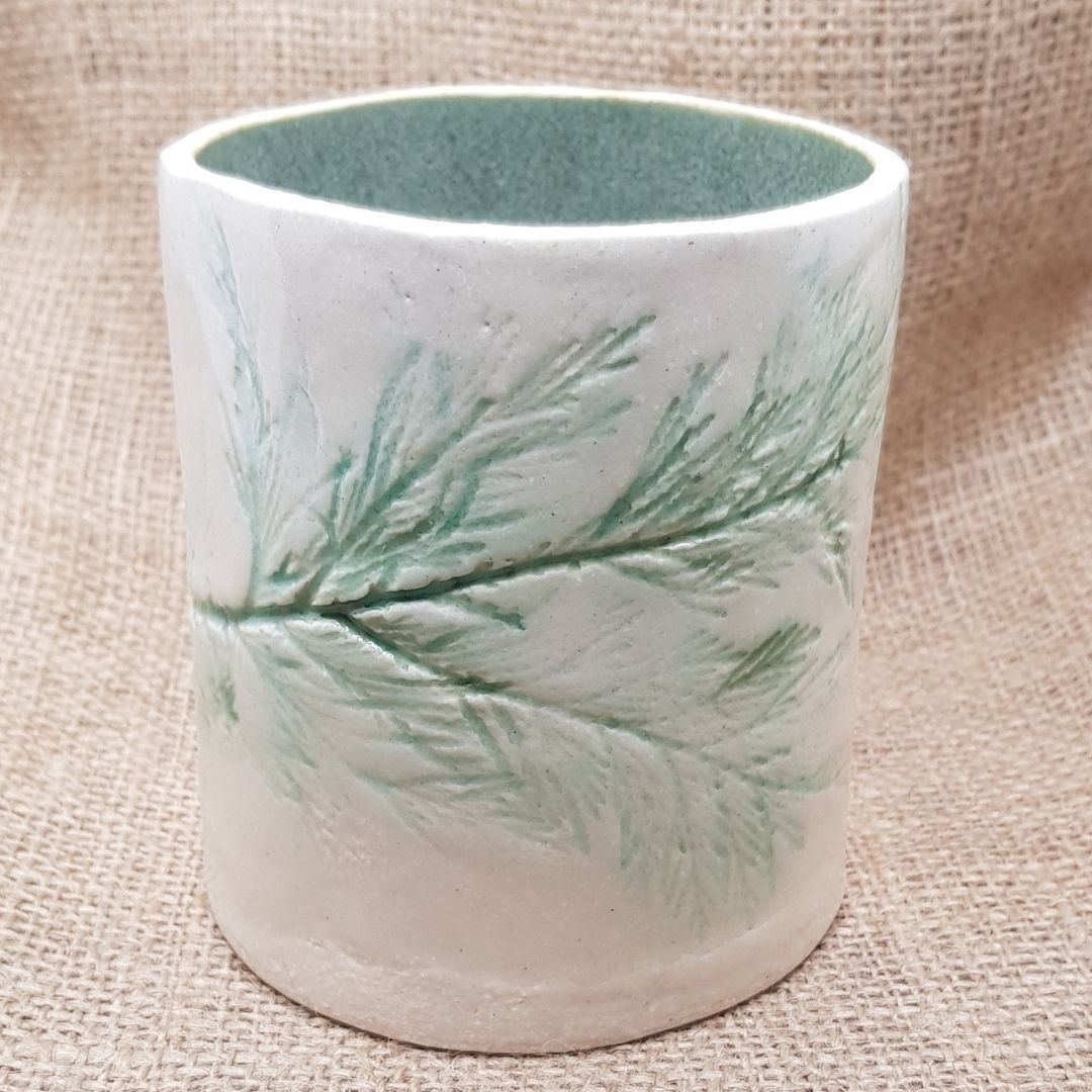 botanical vessel single cupress leaf